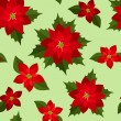 Seamless Christmas background with red poinsettias. Vector illustration. — Stock Vector