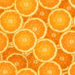Seamless background with orange slices. Vector illustration. — Stock Vector