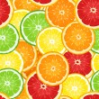 Seamless background with citrus fruits. Vector illustration. — Stock Vector