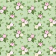 Vector seamless pattern with rose buds and leaves on green. — Stock Vector