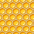 Seamless pattern with honeycombs. Vector illustration. — Stockvectorbeeld