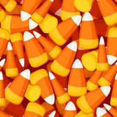 Seamless background with candy corn. Vector illustration. — Stock Vector