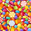 Seamless background with various candies. Vector illustration. — Stock Vector #33992511