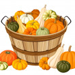 Wooden basket with pumpkins. Vector illustration. — Stock Vector
