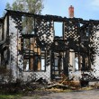 Canada, Quebec,an old charred house in Sainte Madeleine de la Ri - Stock Photo