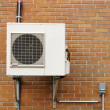 Air conditioning unit outside in Quebec - Stock Photo