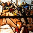 Stained glass window in the church Saint Martin of Triel - Stock Photo