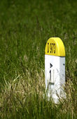 Old kilometre marker in the country — Stock Photo