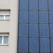 Photovoltaic panels on a wall of a building - Stock Photo