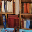 Old books in an antique shop — Stock Photo