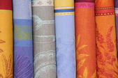 Some rolls of textile on the market — Stock Photo