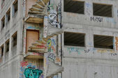Graffiti on a wall of an unfinished building — Stock Photo
