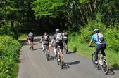 Perigord, cyclists in Saint Vincent le Paluel forest — Stock Photo