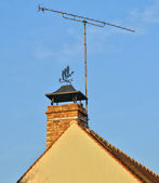 France, an antenna and a weathercock on chimney — Stock Photo