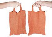 Hand holding orange fabric reusable shopping bag — Stock Photo