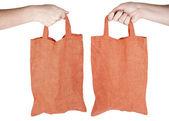 Turuncu kumaş yeniden kullanılabilir alışveriş çantası elinde el — Stok fotoğraf