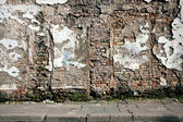 Old wall with immured door — Stock Photo