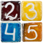 Handmade ceramic numbers — Stock Photo