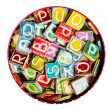 Tin full of colorful handmade ceramic letters    — Stock Photo