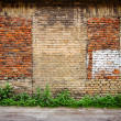Old wall with immured windows — Stock Photo