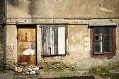 Boarded up window and rusty door — Stock Photo