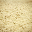 Footsteps on a beach sand — Stock Photo