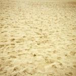 Footsteps on a beach sand — Stock Photo