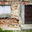 Boarded up window and old door — Stock Photo