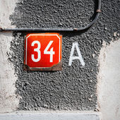 Number 34 A on a wall — Stock Photo