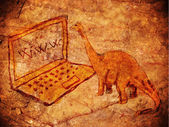 Prehistoric petroglyph with computer and dinosaur — Stock Photo