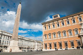 Obelisk and lateran palace at Piazza di Laterano in Roma - Ital — Stock Photo