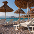 Stock Photo: Deck chairs and sunshade on beach at Bask- Krk - Croatia