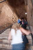 Girl on stairs up inside Colosseum at Rome — Stock Photo