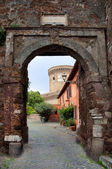 Entrance to Borgo di Ostia antica and Castello di Giulio II at R — Stock Photo