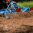 Vibrocultor working on field closeup — Stock Photo