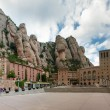 Panoramic view of Montserrat Monastery and stone walls — ストック写真
