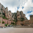 Panoramic view of Montserrat Monastery and stone walls — Stock Photo