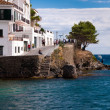 Cadaques seaside street and sea — Stock Photo