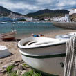 Row boat with rope docked on Cadaques beach — Stok fotoğraf