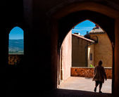 Tourist on passages arcs and windows in Roussillon in France — Stock Photo