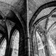 Stock Photo: Cloister corridor arcs look like mirror at Saint Just Cathedra
