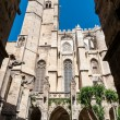 Stock Photo: Saint Just Cathedral sight between arcs in cloister at Narbonne