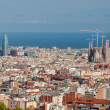 Panoramic view of Barcelona with La Sagrada Familia and Agbar bu — Stock Photo #42041349