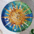 Stock Photo: Season mosaic with orange sun at salHipostilin Park Guell at