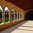 Постер, плакат: Corridor and arcs on St Hilaire abbey in Aude