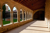 Corridor and arcs on St Hilaire abbey in Aude — Stock Photo