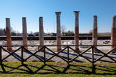 Roman columns and fence on Archeological area of Aquileia — Stock Photo