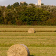 Hay rolls and Belfry — Stock Photo