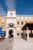 Frane Petrica square and clock tower in Cres — Stock Photo