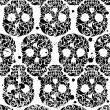 Seamless pattern with skulls — Stock Vector #13036684